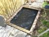 Vi har lagt en ukrudtsdug i bunden, orker ikke mere ukrudt i haven !